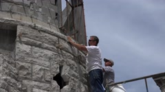 Castle Construction, masons working Stock Footage