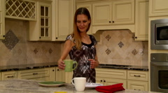Lady in Kitchen with Coffee Stock Footage