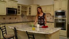 Lady in Kitchen Stock Footage