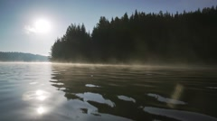 Morning vapors of mountain lake Stock Footage