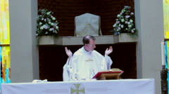 Catholic priest reads from the Bible during Mass. Stock Footage