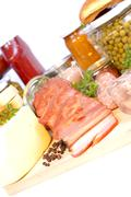 Salami, bacon, aspic, parsley, cheese, peas, pate, preserves, ketchup on wood Stock Photos