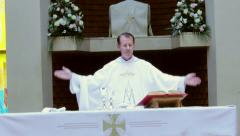 Catholic priest reads prayer from the Bible during Mass. Stock Footage