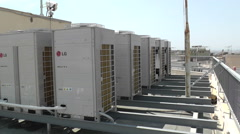 HVAC and Air conditioning units at building roof Stock Footage