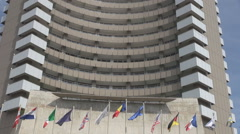 Business building, world wide meeting in important European construction, flags Stock Footage