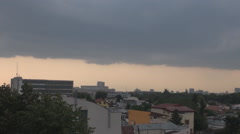 Modern village seen from roof top dark clouds come over city, capricious weather Stock Footage