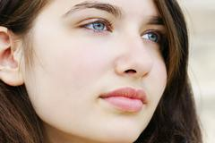 hopeful young woman looking away - stock photo