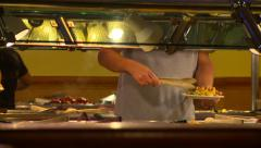 Buffet Guy fills plate Stock Footage