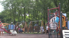 Cute children in park playground, using toys for amusement, kindergarten outside Stock Footage