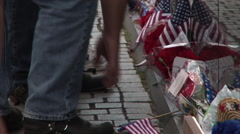 Leaving momentos at the Vietnam Memorial Wall Stock Footage