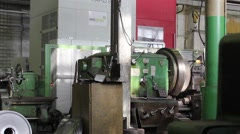 Stock Video Footage of Metal lathe working on heavy industry factory