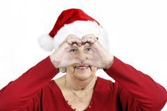 Grandma making heart symbol Stock Photos