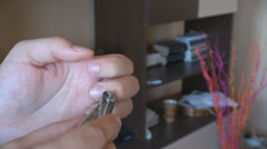 Closeup young man hands using nail clippers, personal hygiene view, man manicure Stock Footage