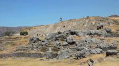 Peru Sacsayhuaman people slide on rocks near inca ruins 4 Stock Footage