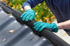 securing gutters - stock photo