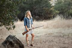 Young Woman In A Field With An Antique Shotgun Stock Photos