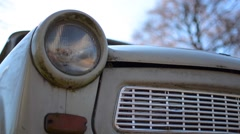 Dolly shot behind trabant car with sun lens flare Stock Footage