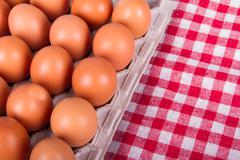 Eggs on table cloth Stock Photos