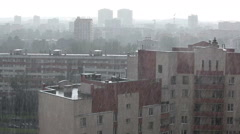 Heavy rain over city sleeping district, view over roofs, Russia Stock Footage