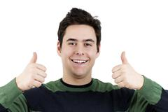 young guy with two thumbs up - stock photo