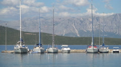 Beautiful yachts moored in the harbor on a sunny summer day. Stock Footage