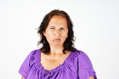 grumpy middle age woman - stock photo