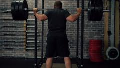 Weightlifter Does Heavy Squats Stock Footage