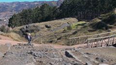 Peru Quenko hiker near bridge at site with ruins 7 Stock Footage