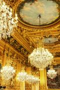 Gold ceiling and chandeliers Stock Photos