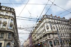 tramway cables criss-cross - stock photo