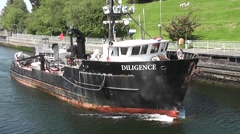 A Work Boat Heads Into the Ballard Locks Stock Footage