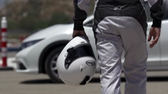 Race car driver walking to the car 2 - stock footage