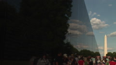 Vietnam Veterans Memorial Wall and Washington Monument Stock Footage