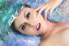 Beauty image of a woman wrapped in cellophane Stock Photos