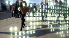 City commuters made of binary code overlaid by a world map made of numbers. - stock footage