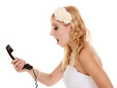 wedding. angry woman fury bride talking on phone - stock photo