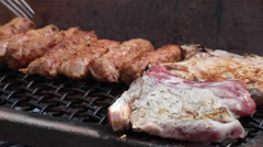 Pork chops and sausages on grill, meat, barbecue, BBQ, cooking, picnic Stock Footage