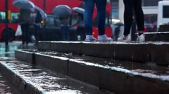 Rainy Day London _ Low angle shot rain hitting busy street - stock footage