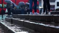 Stock Video Footage of Rainy Day London _ Low angle shot rain hitting busy street
