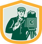 Photographer shooting vintage camera shield retro Stock Illustration