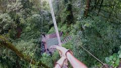 POV of a person Tarzan swinging through the jungle in Monteverde, Costa Rica. Stock Footage