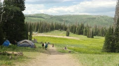 High mountain meadow with campers. Stock Footage