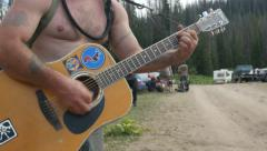 Man with out shirt playing his guitar. Stock Footage