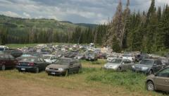 Cars parked in forest at rainbow gathering. Stock Footage