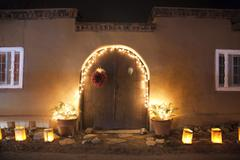 Adobe house Christmas in New Mexico - stock photo
