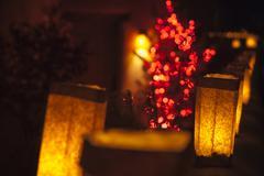 Santa Fe Luminarias and adobe house at Christmas Stock Photos