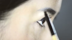 Eye Brow, Asian woman applying make up to her face. Close up. Stock Footage