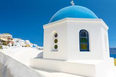 church with blue cupola in santorini, greece - stock photo