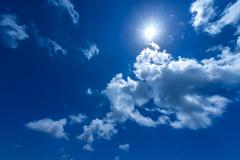 Stock Photo of sun in the bright blue sky