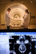 Veterinarian doctor working in MRI scanner room Stock Photos